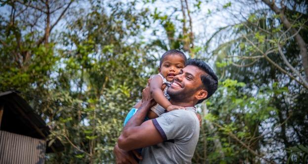 Noornobi hugging his son